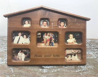 Vintage Wooden Frame in the Shape of a House Holds Eight pictures