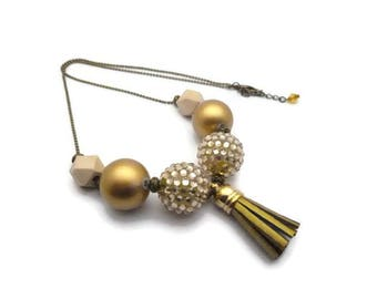 Collier doré pompon bois perles strass