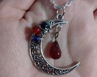 Wire wrapped moon pendant