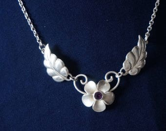 Sterling Silver Chain Necklace with floral design and purple rhinestone