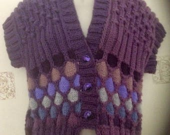 Different color pattern decorates this women's/teen's hand knitted woolen vest