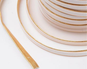 2 meters of 6mm white/gold flat cord