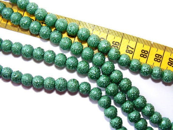 Speckled Emerald 10 x 8mm Pearl round