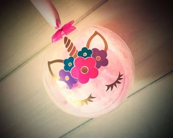 christmas bauble with unicorn design. can be personalised on the back. filled with pink feathers and crystals.