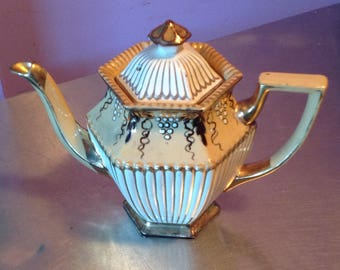 Antique gold and cream tea pot