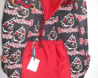 Buccaneers custom made backpack with 4 pockets 1 with a zipper the others have elastic. made from medium wight cotton