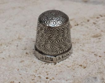 A Tiny Sterling Silver Thimble- Possibly For A Child