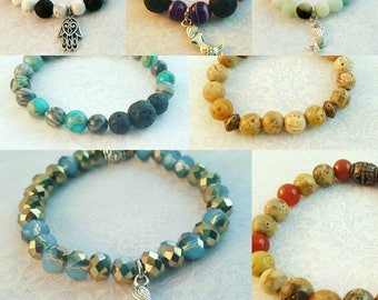 Beaded bracelets and essential oil diffuser, natural stone, glass, crystal, and metal.