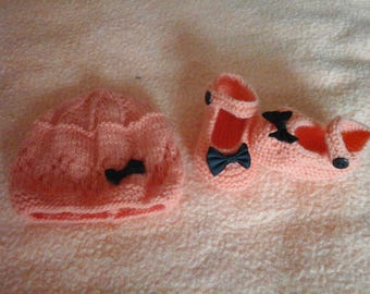 Hat and orange baby shoes slippers