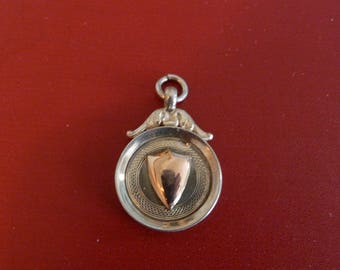 silver and gold watch fob