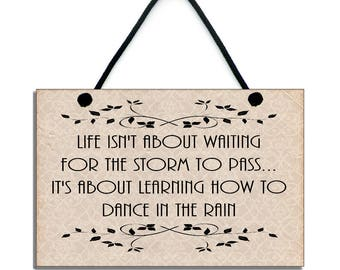 Wooden ' Life Isn't About Waiting For The Storm To Pass ' Quote 136