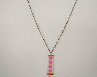 pink heart necklace and tassels
