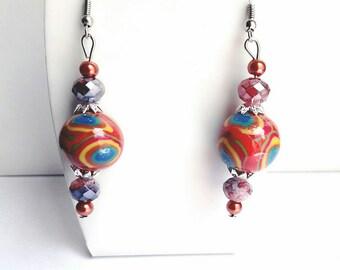 Earrings in bright colors, multicolored spheres.