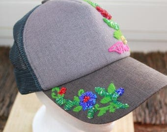 Baseball cap bought already embroidered -- embellished with beads.