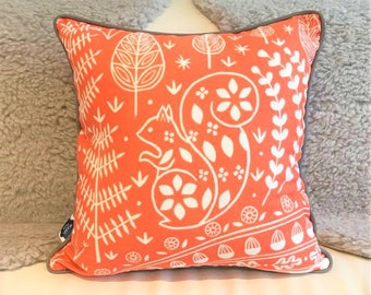 Edward Squirrel cushion cover, orange with grey piping, scandi lifestyle interiors