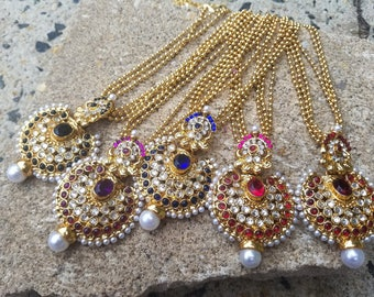 Kundan rhinestone necklace set with large multistone pendant & earrings. Available in multiple colors.