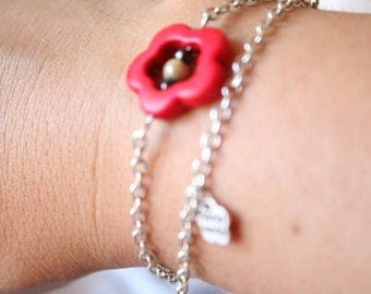 Double bracelet with red howlite orange flower