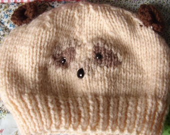 Knitted hat with ferret on