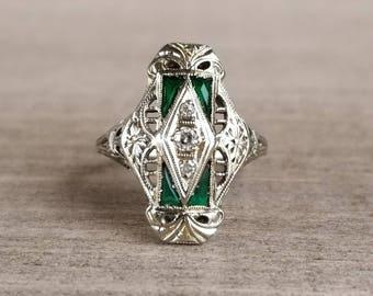 Stunning diamond shield ring in 18k white gold