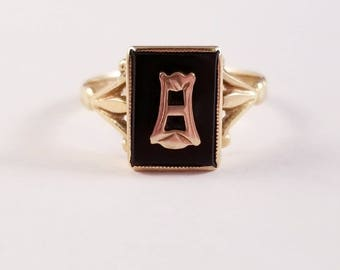 Vintage onyx ring with letter A in yellow gold