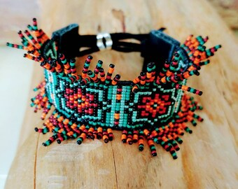 Colorfull loom beaded seed beads bracelet with leather and slide bead.