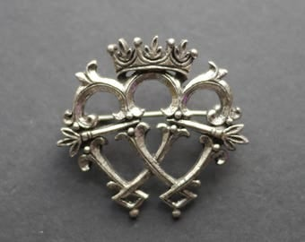 Miracle signed Celtic brooch, double heart and crown