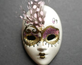 Mask brooch, vintage 1980s painted white plastic mask with glitter and feather