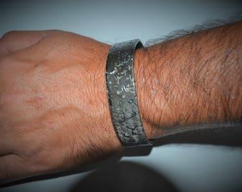 An iron bracelet. metal art. blacksmith. bangle. iron jewelry