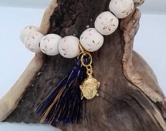 Wood bracelet, blue tassel and Buddha