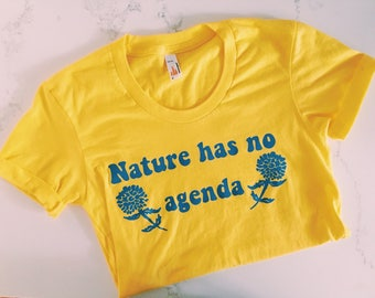 Nature Has No Agenda Womens Yellow T Shirt with Blue Font