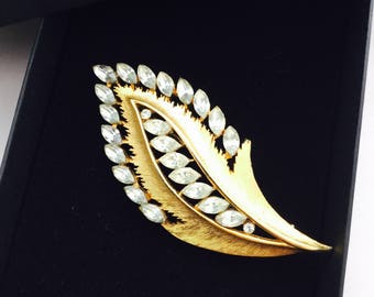 1960's signed J.J. Goldtone and Rhinestone Brooch