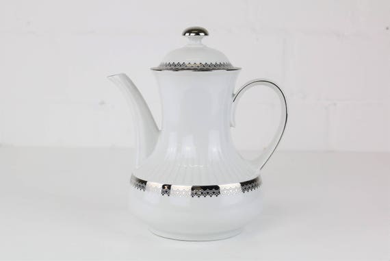 White vintage teapot with exceptional shape and silver details antique coffee pot