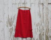 Red cotton midi skirt, bottom pleating and button detail, made in Mt. Kisco, New York, medium, 1970s, medium length skirt