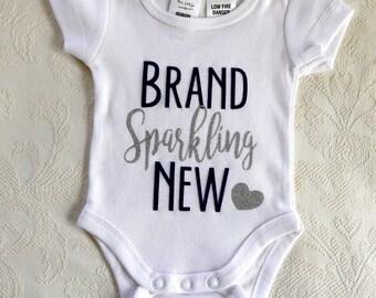 Newborn Onesie, Baby Gift, Short sleeve onesie, Blue and silver sparkle HTV vinyl, Size 0000 Newborn