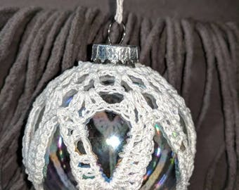Hand crochet clear glass big Christmas ornament.