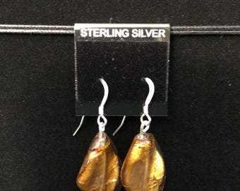 Beautiful amber colored stone set on sterling silver wire and post.