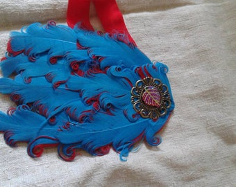 headband red and blue feathers adorned with a leaf