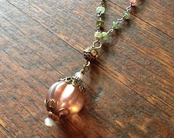 Victorian style mauve colored bead on a tourmaline rosary chain.