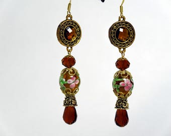 Dangle earring with pink flowered lamp work bead, topaz beads and gold colored findings