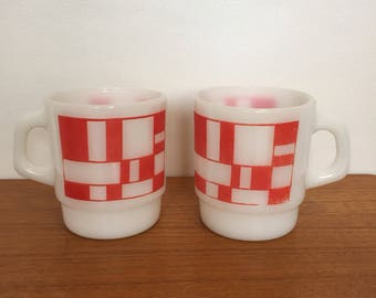 Two red & white mid century Anchor Hocking Fire-king mugs