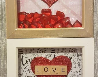 Frames with Scrabble Letter with wooden heart with the wording LOVE and Red Plastic hearts.