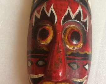 Hand painted red African mask