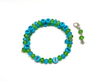 Breastfeeding bracelet beads figures blue color, glass beads faceted green and blue, with star steel clasp charm