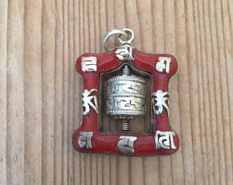 Mane prayer wheel pendant