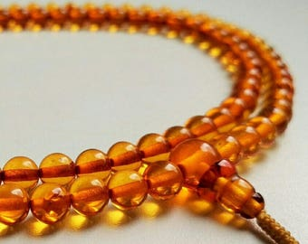 108 bead amber mala (size Ø6 mm, colour no. 4)