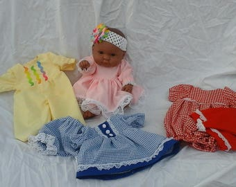 14 inch baby doll and wardrobe