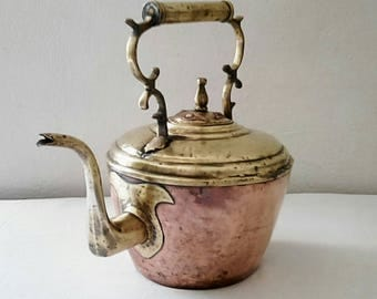 Antique copper kettle and brass. France 1910
