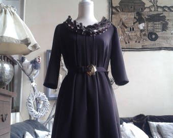 vintage dress with her chest and very retro belt