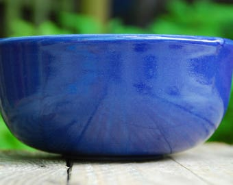 Handmade, thrown, and turned stoneware bowl. Blue decorating slip with blue glaze.