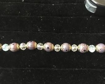 Beaded purple and gold bracelet